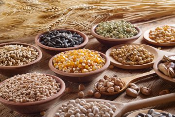 52160887 - cereal grains , seeds, beans on wooden background.